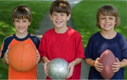 Children holding balls