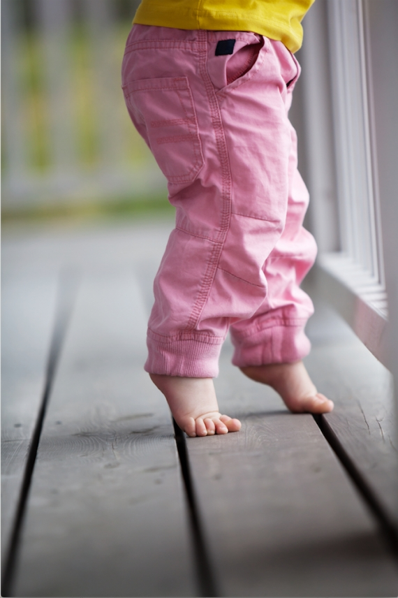 Young child standing on toes