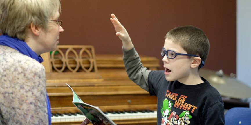 Music therapist works with child