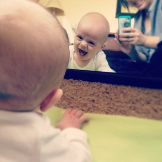 Baby looking in mirror while on tummy