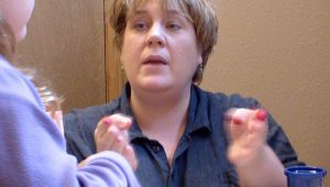 Therapist in Traverse City works with child